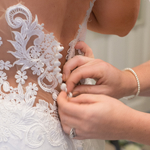 Country-Villa-bride-buttoning-dress